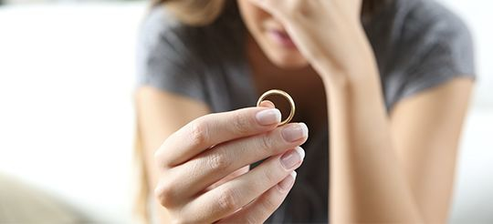 Woman holding wedding band - Danbury divorce attorney